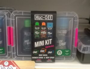 Muc-Off body products in reusable container with closures in their signature hot pink